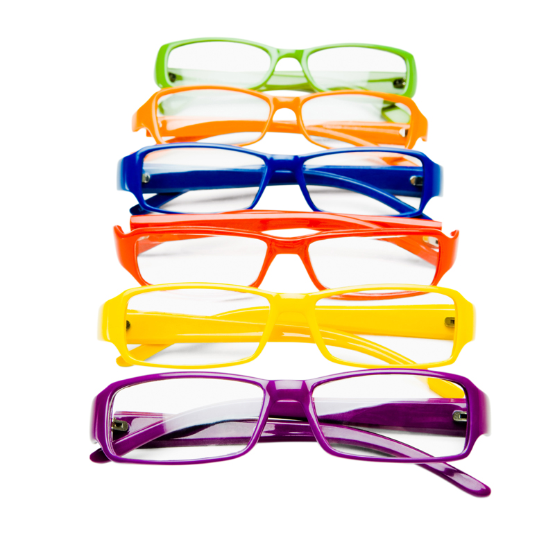 Row of colorful eyeglasses isolated over white