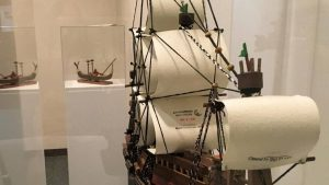 Image of boat with billowed sails, crafted from found materials