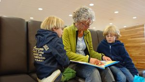 adult reading book to children