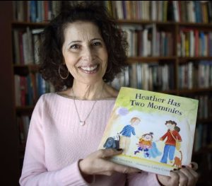 """Leslea Newman with her children's book """"Heather Has Two Mommies"""