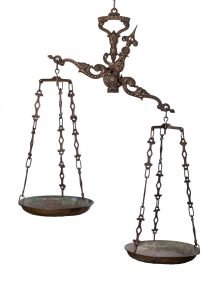 antique hanging scales tipped to the right