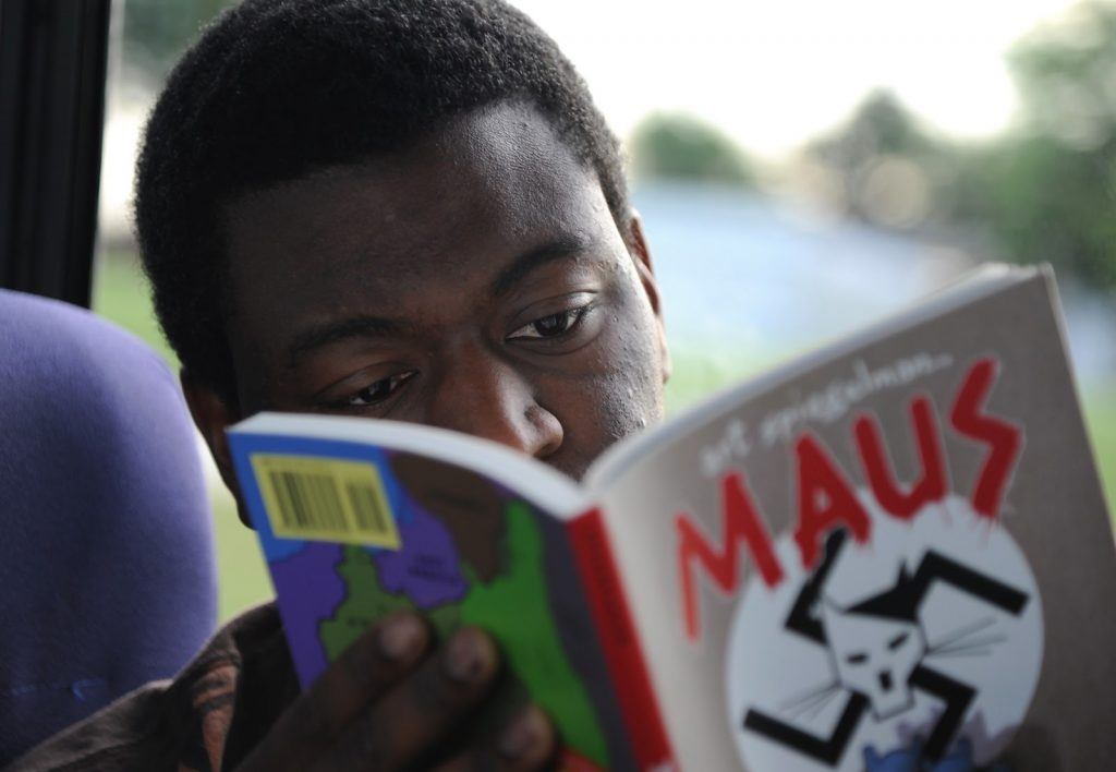 Senior Airman Alton Kelly reads a copy of Spiegelman's Maus, photo by Vance Air Force Base, licensed for reuse