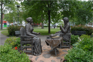 """Photo of Rochester NY sculpture of SB Anthony and F Douglass 'Let's Have Tea' from Rochester Public Library collection, approved for """"non-commercial, personal, educational, or research use"""""""