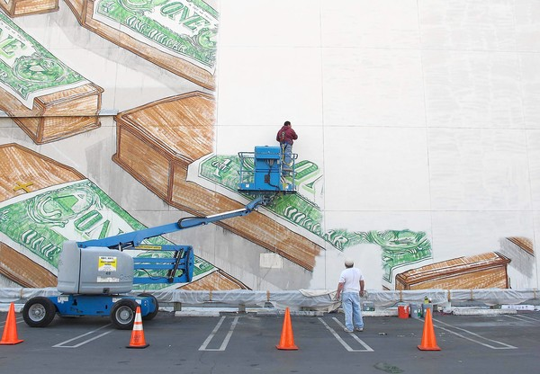 Photo shows painters at work covering the mural with a coat of paint. Credit: National Coalition Against Censorship