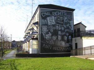 Civil rights mural in Derry, Ireland with jobs not creed sign